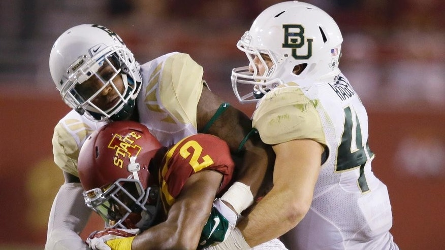 Iowa State running back Aaron Wimberly (2) is tackled by Baylor safety Orion Stewart and linebacker Bryce Hager, right, during the second half of an NCAA college football game, Saturday, Sept. 27, 2014, in Ames, Iowa. Baylor won 49-28. (AP Photo/Charlie Neibergall)