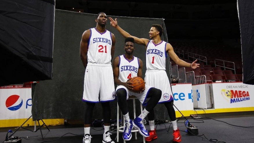 Philadelphia 76ers' Joel Embiid, left, of Cameroon, Nerlens Noel, right, and Michael Carter-Williams joke with one another as they poses for a photographer during the NBA basketball team's media day, Monday, Sept. 29, 2014, in Philadelphia. (AP Photo/Matt Slocum)