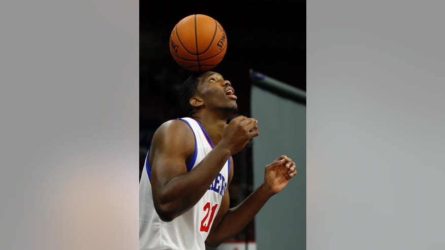 Philadelphia 76ers' Joel Embiid, of Cameroon, poses for a photographer during the NBA basketball team's media day, Monday, Sept. 29, 2014, in Philadelphia. (AP Photo/Matt Slocum)