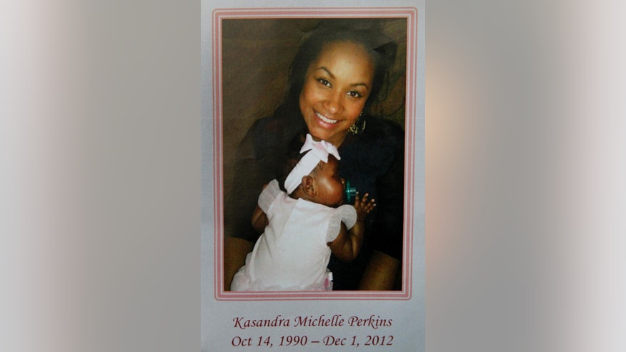 FILE - This Dec. 6, 2012, file photo, of a funeral service pamphlet provided by the family of Kasandra Perkins shows Perkins holding her daughter Zoey. An autopsy released Monday, Sept. 25, 2014 by attorneys of Kansas City Chiefs linebacker Jovan Belcher's family, that was performed a year after Belcher killed Perkins and himself, found the 25-year-old sustained the same kind of brain damage that has turned up in other NFL players. Belcher fatally shot 22-year-old Perkins on Dec. 1, 2012, at their Kansas City homebefore driving to Arrowhead Stadium and killing himself in front of the team's general manager and head coach. Zoey survived. (AP Photo/Courtesy Perkins Family, File)