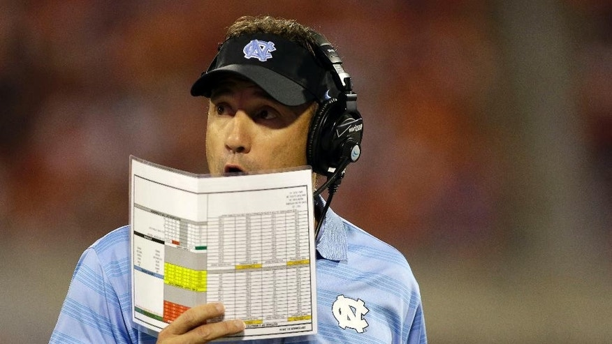 North Carolina head coach Larry Fedora on the sideline during the first half against Clemson during an NCAA college football game in Clemson, S.C., Saturday Sept. 27, 2014. (AP Photo/Bob Leverone)