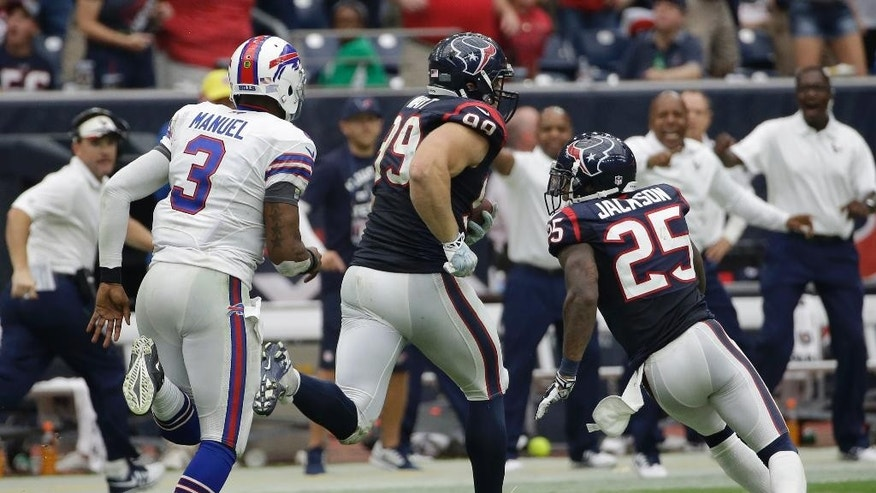 Houston Texans' J.J. Watt (99) chased by Buffalo Bills' EJ Manuel (3) after Watt intercepted a his pass during the third quarter of an NFL football game, Sunday, Sept. 28, 2014, in Houston. Watt returned the ball 80 yards for a touchdown.(AP Photo/David J. Phillip)