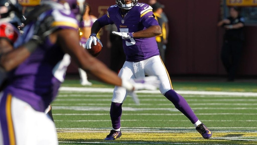 Minnesota Vikings quarterback Teddy Bridgewater looks to pass during the first half of an NFL football game against the Atlanta Falcons, Sunday, Sept. 28, 2014, in Minneapolis. (AP Photo/Ann Heisenfelt)