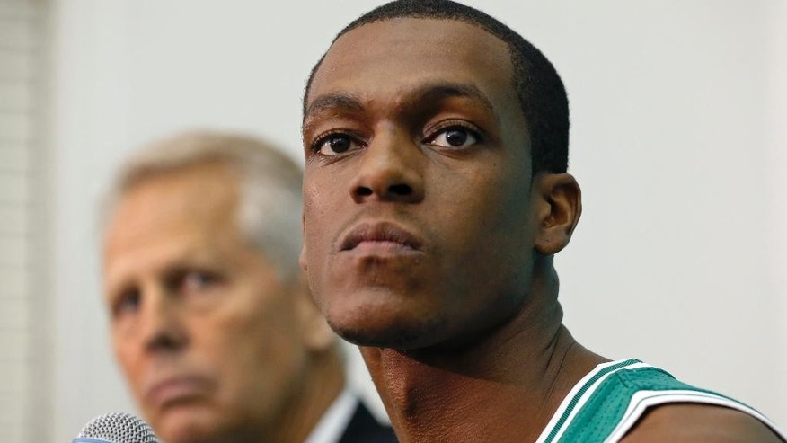 Boston Celtics guard Rajon Rondo listens to a question alongside President of Basketball Operations Danny Ainge during NBA basketball media day in Waltham, Mass., Monday, Sept. 29, 2014. (AP Photo/Elise Amendola)