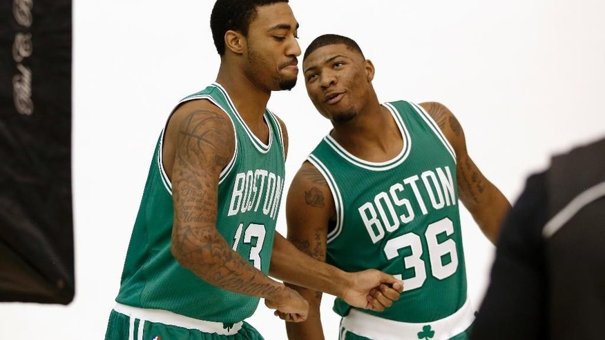 Boston Celtics guard James Young, left, and guard Marcus Smart, right, joke around during a photo shoot at NBA basketball media day, Monday, Sept. 29, 2014, in Waltham, Mass. (AP Photo/Steven Senne)