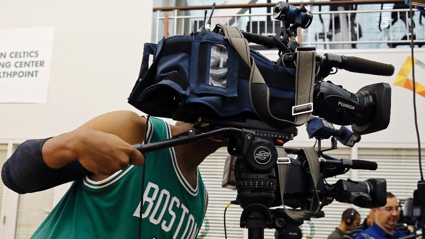 Boston Celtics forward Jared Sullinger (7) checks out the viewfinder of a TV camera during Boston Celtics basketball team media day in Waltham, Mass., Monday, Sept. 29, 2014. (AP Photo/Elise Amendola)