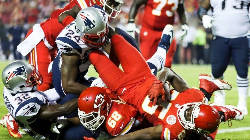 Kansas City Chiefs running back Jamaal Charles, front right, falls into the end zone after catching a 5-yard pass for a touchdown during the second quarter of an NFL football game against the New England Patriots, Monday, Sept. 29, 2014, in Kansas City, Mo. (AP Photo/Ed Zurga)