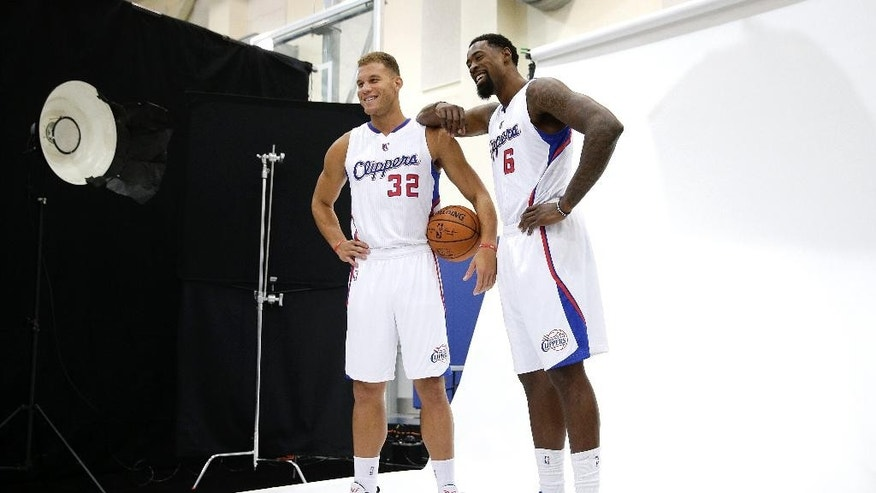 Los Angeles Clippers' Blake Griffin, left, and DeAndre Jordan pose for photos during the team's NBA basketball media day Monday, Sept. 29, 2014, in Los Angeles. (AP Photo/Jae C. Hong)