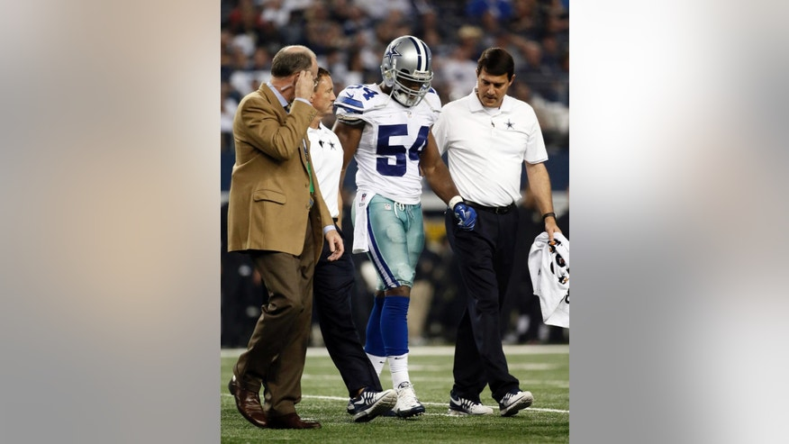 Dallas Cowboys medical staff assist outside linebacker Bruce Carter (54) off the field with an unknown injury during the second half of an NFL football game against the New Orleans Saints, Sunday, Sept. 28, 2014, in Arlington, Texas. (AP Photo/Brandon Wade)