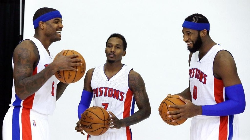 Detroit Pistons forward Josh Smith, left, guard Brandon Jennings, center, and center Andre Drummond stand around during media day at the NBA team's basketball training facility in Auburn Hills, Mich., Monday, Sept. 29, 2014. (AP Photo/Carlos Osorio)