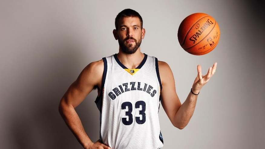 Memphis Grizzlies center Marc Gasol poses for a picture during the team's NBA basketball media day on Monday, Sept. 29, 2014, in Memphis, Tenn. Last season ended with the Grizzlies ousted in the first-round of the playoffs in seven games by Oklahoma City after failing to close out the Thunder in Memphis in Game 6. (AP Photo/Mark Humphrey)