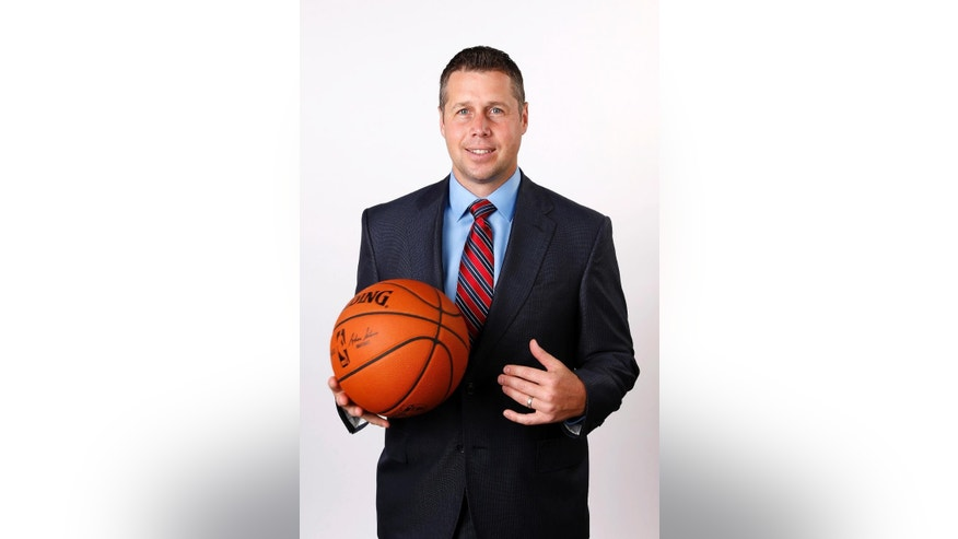 Memphis Grizzlies head coach David Joerger poses for a picture during the team's NBA basketball media day on Monday, Sept. 29, 2014, in Memphis, Tenn. Last season ended with the Grizzlies ousted in the first-round of the playoffs in seven games by Oklahoma City after failing to close out the Thunder in Memphis in Game 6. (AP Photo/Mark Humphrey)