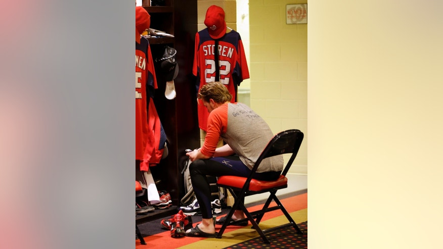 FILE - In this Oct. 13, 2012 file photo, Washington Nationals relief pitcher Drew Storen sits by his locker after Game 5 of the National League division baseball series against the St. Louis Cardinals, in Washington. St. Louis won 9-7. The baseball playoffs are not only a second season but a second chance for the likes of Clayton Kershaw of the Dodgers, Adam Jones of the Orioles and Drew Storen of the Nationals to atone for past playoff flops. (AP Photo/Pablo Martinez Monsivais, File)