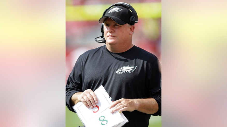 Philadelphia Eagles head coach Chip Kelly watches from the sideline during the first half of an NFL football game against the San Francisco 49ers in Santa Clara, Calif., Sunday, Sept. 28, 2014. (AP Photo/Ben Margot)