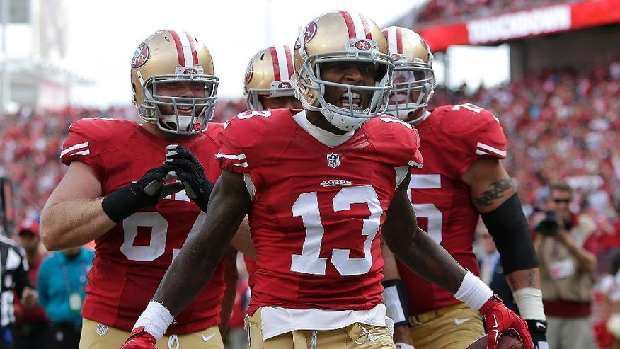 San Francisco 49ers wide receiver Steve Johnson (13) celebrates with teammates after catching a 12-yard touchdown against the Philadelphia Eagles during the third quarter of an NFL football game in Santa Clara, Calif., Sunday, Sept. 28, 2014. (AP Photo/Marcio Jose Sanchez)