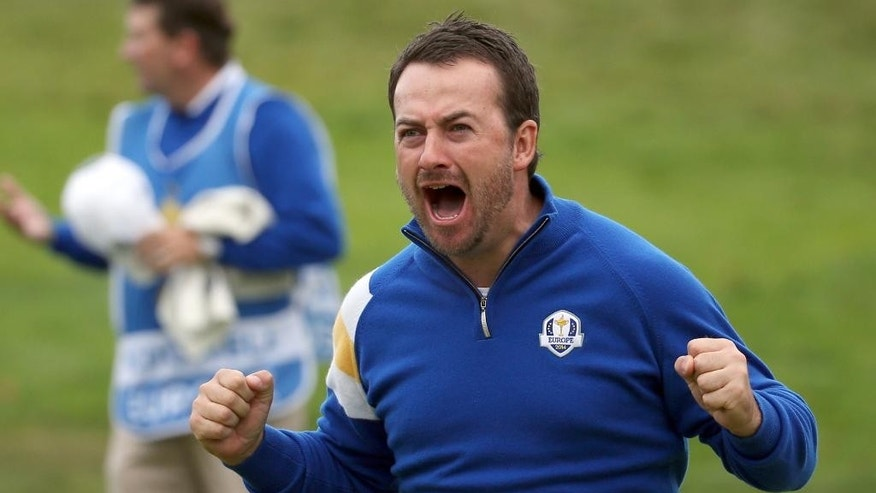 Europe's Graeme McDowell celebrates on the 17th green after winning his singles match against Jordan Spieth of the US on the final day of the Ryder Cup golf tournament, at Gleneagles, Scotland, Sunday, Sept. 28, 2014. (AP Photo/Scott Heppell)