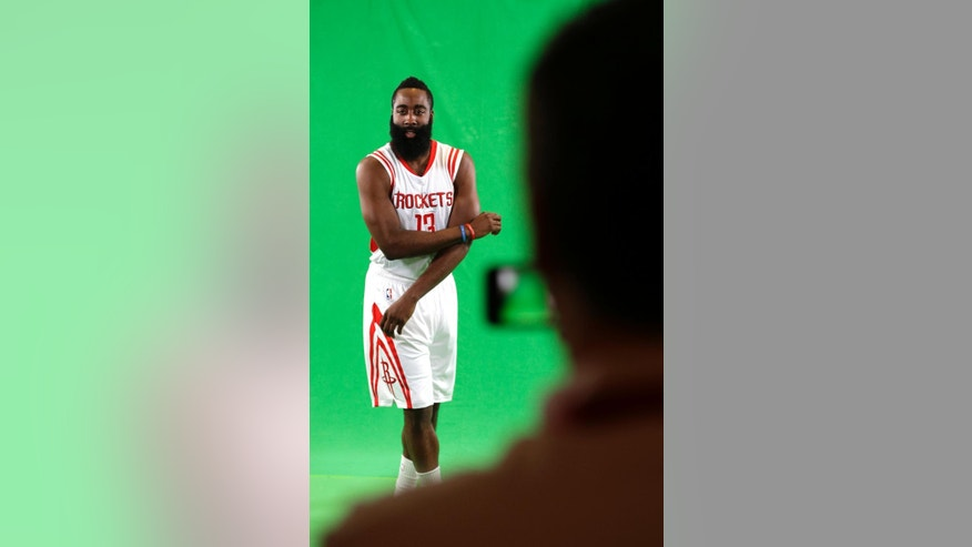 Houston Rockets' James Harden dances while being filmed NBA basketball media day Monday, Sept. 29, 2014, in Houston. (AP Photo/David J. Phillip)
