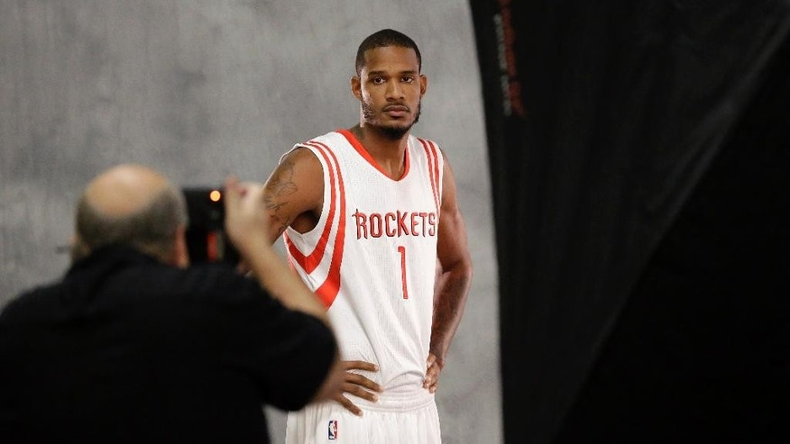 Houston Rockets' Trevor Ariza poses for a photographer NBA basketball media day Monday, Sept. 29, 2014, in Houston. (AP Photo/David J. Phillip)