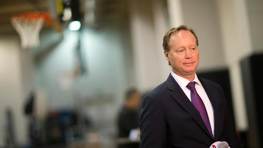 Atlanta Hawks head coach Mike Budenholzer waits for a television interview to begin during NBA basketball media day, Monday, Sept. 29, 2014, in Atlanta. (AP Photo/David Goldman)