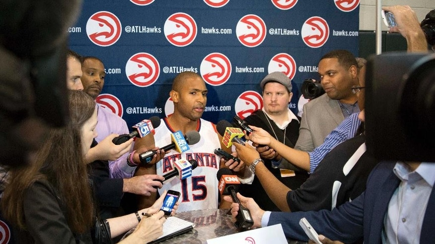 Atlanta Hawks' Al Horford is interviewed during NBA basketball media day, Monday, Sept. 29, 2014, in Atlanta. (AP Photo/David Goldman)