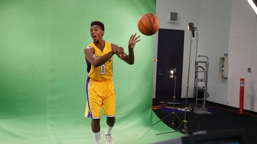 Los Angeles Lakers' Nick Young tosses the ball during a video shoot on the team's NBA basketball media day Monday, Sept. 29, 2014, in El Segundo, Calif. (AP Photo/Jae C. Hong)