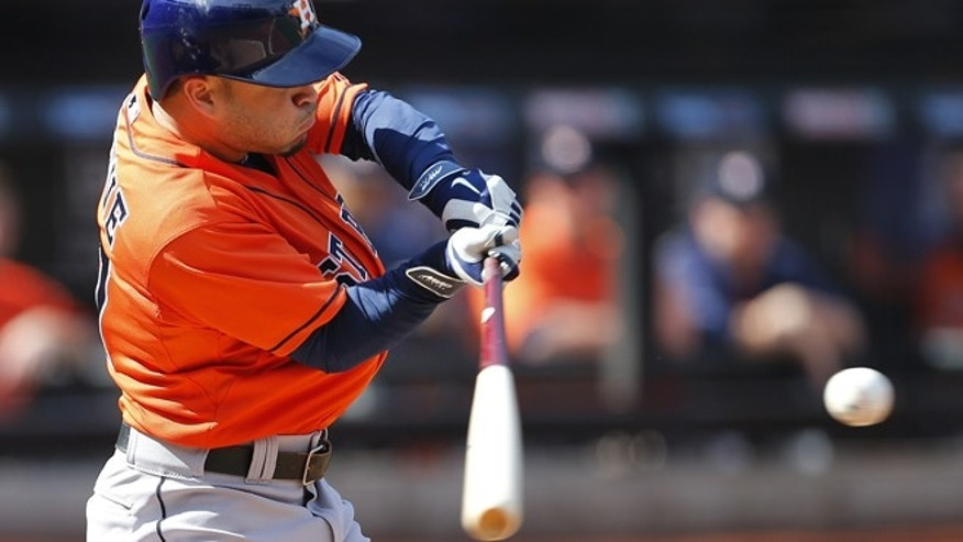 Houston Astros Jose Altuve (27) hits a double against the New York Mets during the third inning of an inter-league baseball game Sunday, Sept. 28, 2014 at Citi Field in New York. The mets defeated the Astros 8-3. (AP Photo/Rich Schultz)