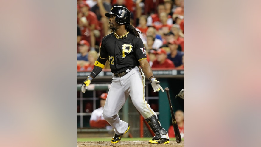 Pittsburgh Pirates' Andrew McCutchen hits a double to drive in a run in the eighth inning of a baseball game against the Cincinnati Reds, Friday, Sept. 26, 2014, in Cincinnati. Pittsburgh won 3-1. (AP Photo/Al Behrman)