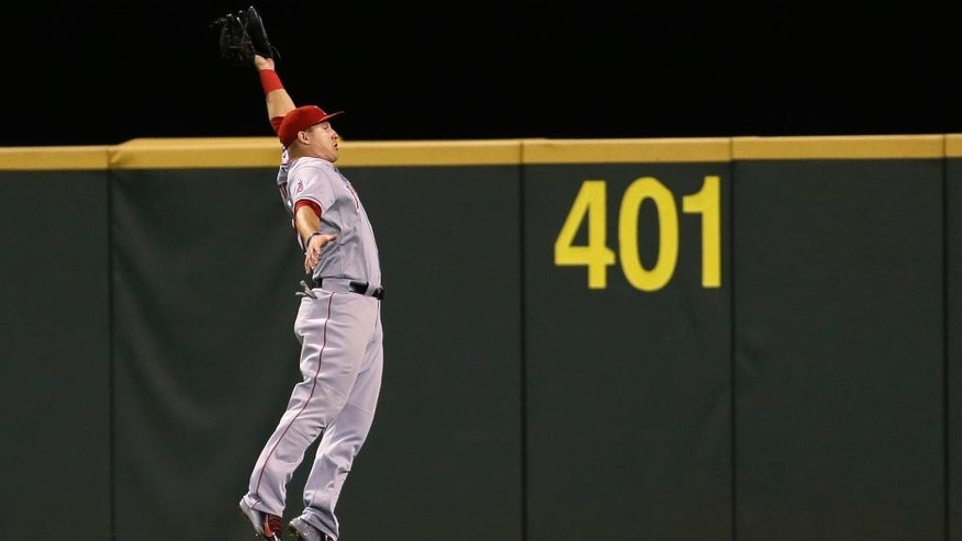 Los Angeles Angels center fielder Mike Trout makes a leaping catch on the run of a ball hit by Seattle Mariners' Kendrys Morales in the eighth inning of a baseball game, Friday, Sept. 26, 2014, in Seattle. The Mariners won 4-3. (AP Photo/Ted S. Warren)