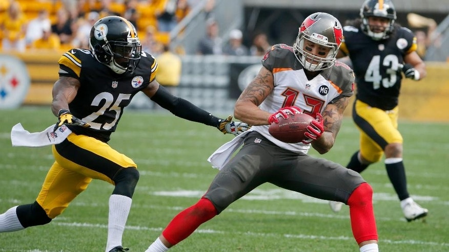 Tampa Bay Buccaneers wide receiver Mike Evans (13) makes a catch in front of Pittsburgh Steelers cornerback Brice McCain (25) during an NFL football game on Sunday, Sept. 28, 2014 in Pittsburgh. (AP Photo/Gene J. Puskar)