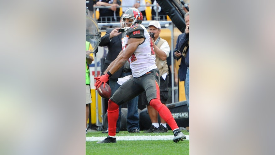 Tampa Bay Buccaneers wide receiver Vincent Jackson spikes the football after making a touchdown catch with only 7 seconds remaining in an NFL football game against the Pittsburgh Steelers on Sunday, Sept. 28, 2014, in Pittsburgh. Th score lifted the Bucs to a 27-24 win. (AP Photo/Don Wright)