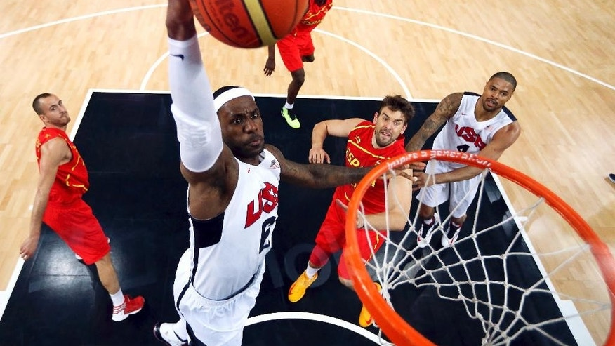 "FILE - In this Aug. 12, 2012, file photo, United States' LeBron James (6) dunks against Spain during the men's gold medal basketball game at the 2012 Summer Olympics in London. James said Monday, Sept. 29, 2014, following the Cavaliers' practice that he's ""nowhere near"" deciding if he'll again play for Team USA in two years for the 2016 Olympics. (AP Photo/Christian Petersen, Pool, File)"