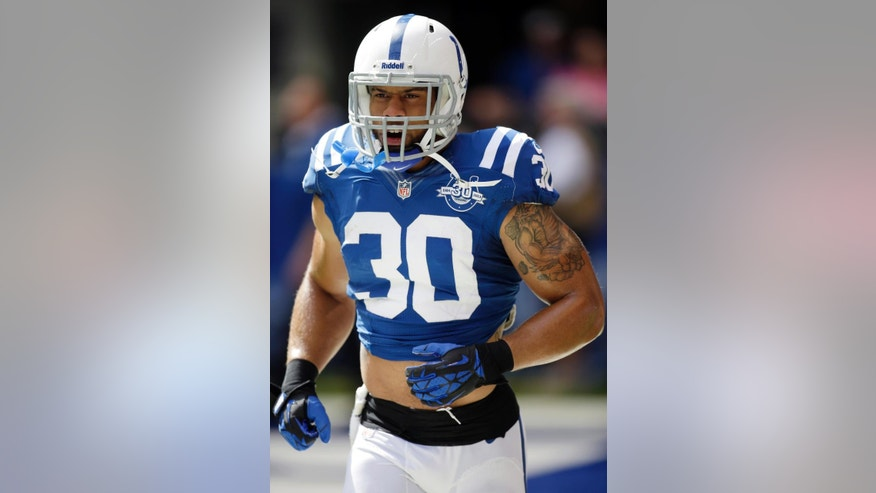 FILE - In this Sept. 15, 2013, file photo, Indianapolis Colts safety LaRon Landry runs onto the field before an NFL football game against the Miami Dolphins in Indianapolis. Landry has been suspended four games without pay for violating the NFL's performance-enhancing substance policy, the league announced, Monday, Sept. 29, 2014. (AP Photo/AJ Mast, File)