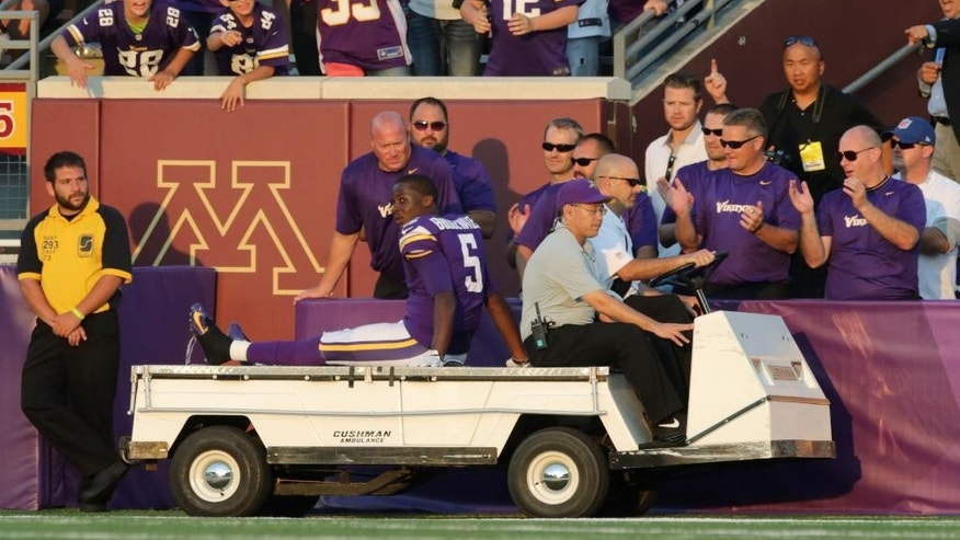 Minnesota Vikings quarterback Teddy Bridgewater is taken off the field on a cart after an injury during the second half of an NFL football game against the Atlanta Falcons, Sunday, Sept. 28, 2014, in Minneapolis. (AP Photo/Jim Mone)