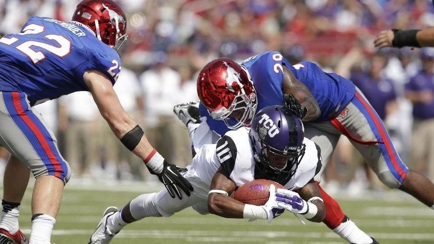 TCU wide receiver Desmon White (10) dives in scoring a touchdown against SMU defensive backs Hayden Greenbauer (22) and Darrion Richardson (29) during the second half of an NCAA college football game Saturday, Sept. 27, 2014, in Dallas. TCU won 56-0. (AP Photo/LM Otero)