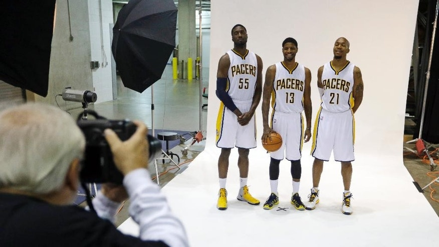 Indiana Pacers center Roy Hibbert, left, forward Paul George, center, and forward David West poses for a photo during the NBA basketball team's media day in Indianapolis, Monday, Sept. 29, 2014. (AP Photo/Michael Conroy)
