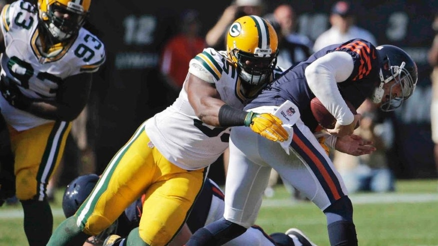 Green Bay Packers defensive end Datone Jones (95) sacks Chicago Bears quarterback Jay Cutler (6) in the second half of an NFL football game Sunday, Sept. 28, 2014, in Chicago. The Packers won 38-17. (AP Photo/Charles Rex Arbogast)