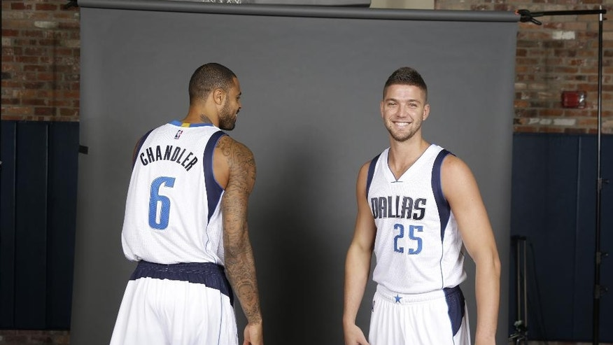 Dallas Mavericks Chandler Parsons (25) laughs with Tyson Chandler (6) after they joked about people confusing them based on name during NBA basketball media day in Dallas, Monday, Sept. 29, 2014. (AP Photo/LM Otero)