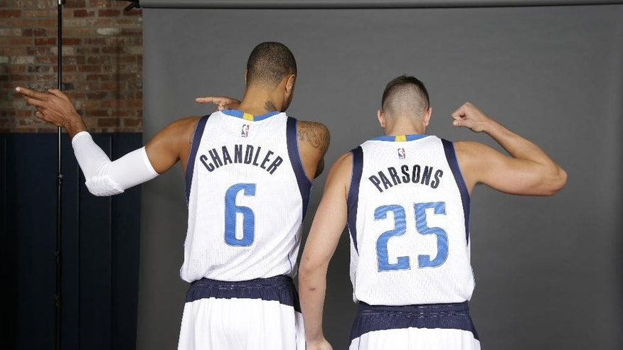 Dallas Mavericks Chandler Parsons (25) and Tyson Chandler (6) playfully show their numbers to avoid confusing them based on name during NBA basketball media day in Dallas, Monday, Sept. 29, 2014. (AP Photo/LM Otero)