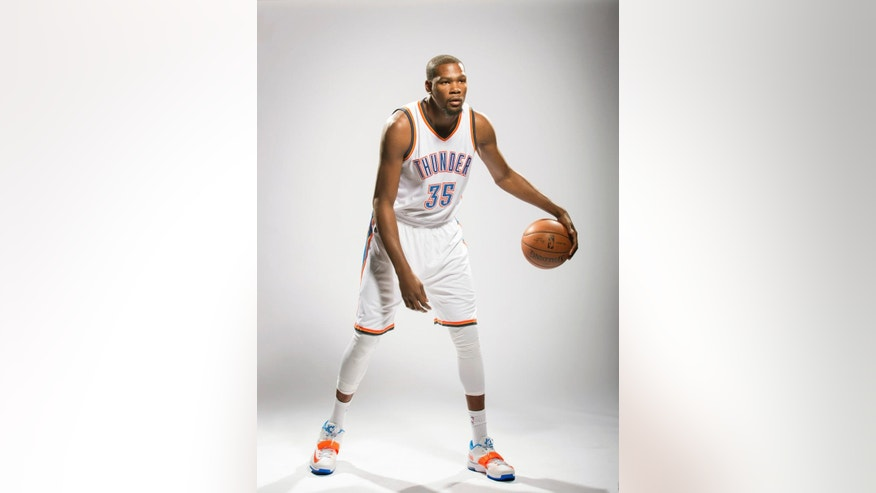 Oklahoma City Thunder's Kevin Durant poses for photos during NBA basketball media day at Chesapeake Energy Arena, Monday, Sept. 29, 2014 in Oklahoma City. (AP Photo/Brett Deering)