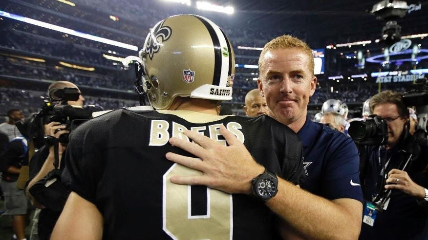 New Orleans Saints' Drew Brees (9) is greeted at midfield by Dallas Cowboys head coach Jason Garrett following an NFL football game, Sunday, Sept. 28, 2014, in Arlington, Texas. The Cowboys won 38-17. (AP Photo/Tim Sharp)