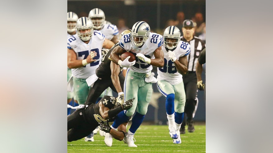 Dallas Cowboys running back DeMarco Murray (29) get a first down tackled by New Orleans Saints cornerback Corey White (24) during the first half of an NFL football game Sunday, Sept. 28, 2014 in Arlington, Texas. (AP Photo/Waco Tribune Herald/ Jose Yau)