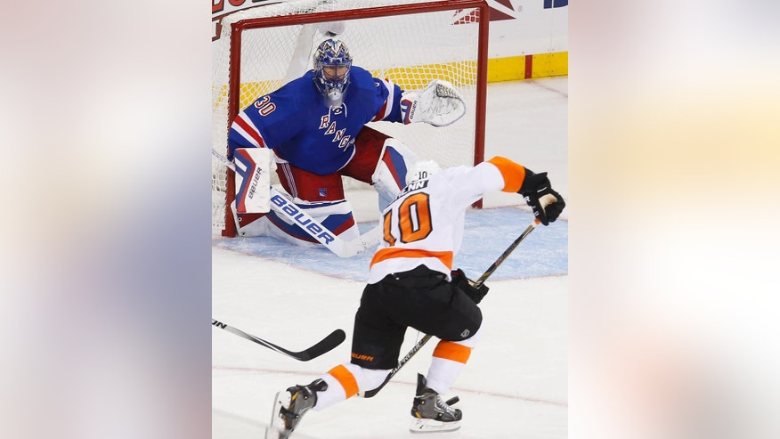 New York Rangers goalie Henrik Lundqvist (30), of Sweden, eyes Philadelphia Flyers' Brayden Schenn (10) as he defends the goal during the third period of an NHL preseason hockey game Monday, Sept. 29, 2014, in New York.  New York beat Philadelphia 6-3. (AP Photo/Jason DeCrow)