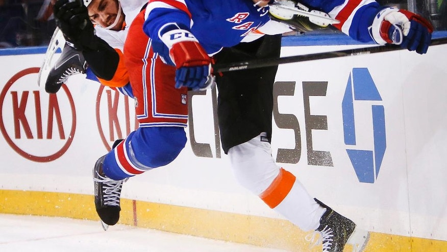 Philadelphia Flyers' Zac Rinaldo, left, and New York Rangers' Matt Hunwick (44) collide during the first period of an NHL preseason hockey game Monday, Sept. 29, 2014, in New York. (AP Photo/Jason DeCrow)
