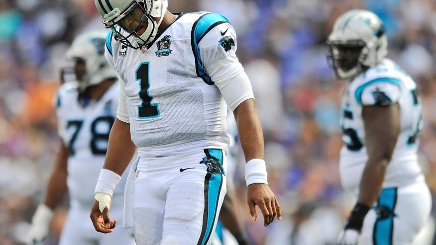 Carolina Panthers quarterback Cam Newton (1) walks off the field during the second half of an NFL football game against the Baltimore Ravens in Baltimore, Sunday, Sept. 28, 2014. (AP Photo/Gail Burton)