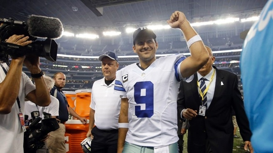 Dallas Cowboys' Tony Romo (9) celebrates as he walks off the field following the team's 38-17 win over the New Orleans Saints in an NFL football game, Sunday, Sept. 28, 2014, in Arlington, Texas. (AP Photo/Tim Sharp)