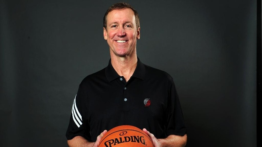 Portland Trail Blazers head coach Terry Stotts poses for a photo during media day in Portland, Ore., Monday, Sept. 29, 2014. (AP Photo/Steve Dykes)