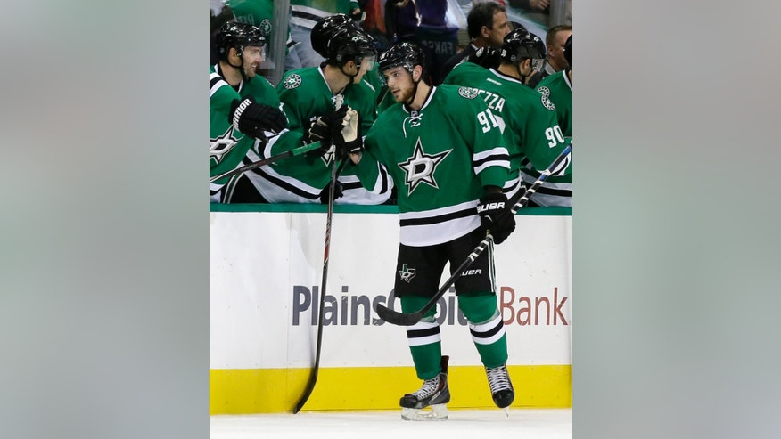 Dallas Stars' Tyler Seguin (91) is congratulated by the bench after scoring a goal in the second period of a preseason NHL hockey game against the Florida Panthers, Monday, Sept. 29, 2014, in Dallas. (AP Photo/Tony Gutierrez)