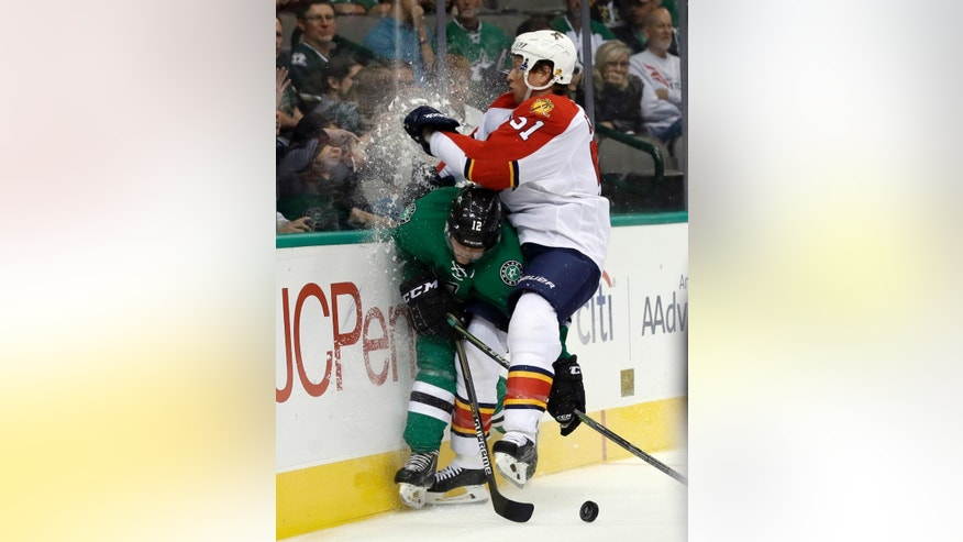 Dallas Stars' Radek Faksa (12) of Czech Republic is checked against the boards by Florida Panthers' Brian Campbell (51) as the two chase a loose puck in the first period of an preseason NHL hockey game, Monday, Sept. 29, 2014, in Dallas. (AP Photo/Tony Gutierrez)