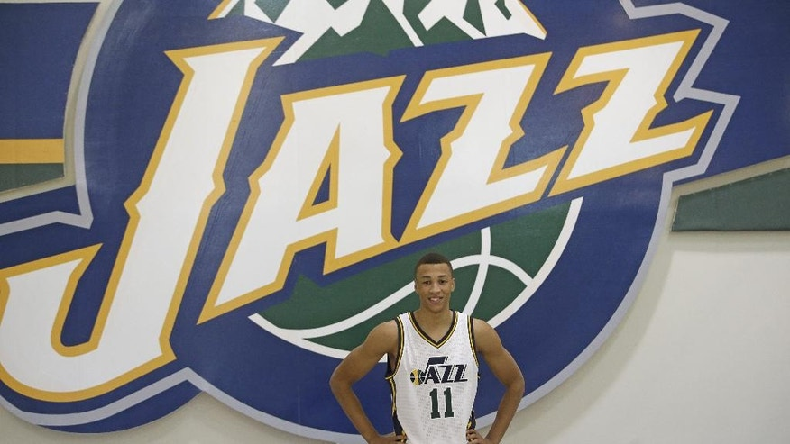 Utah Jazz's Dante Exum, of Australia, poses for a photo during the NBA basketball media day Monday, Sept. 29, 2014, in Salt Lake City. (AP Photo/Rick Bowmer)