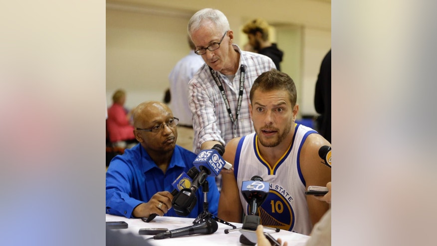 Golden State Warriors' David Lee, right, answers questions from reporters during NBA basketball media day, Monday, Sept. 29, 2014, in Oakland, Calif. (AP Photo/Ben Margot)